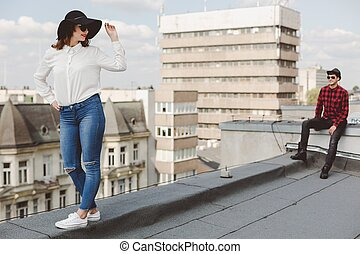 Couple on rooftop - Young original couple spending summer...