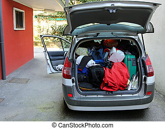 trunk of the car overloaded with bags and luggage