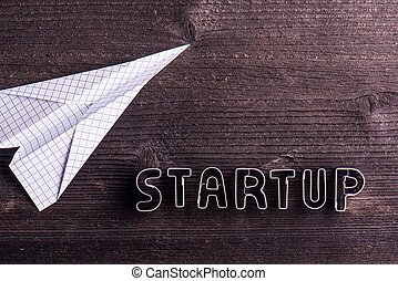 Office desk with start up sign and paper plane. - Office...