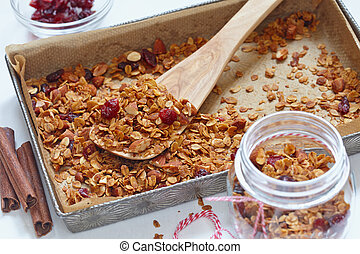 Homemade granola, muesli in a baking pan - Homemade cinnamon...