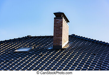 house with a gable roof window - chimney on the roof of the...