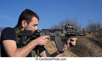 man firing customised russian machine gun, medium - Casually...