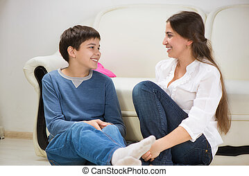 Teen boy with his young mother at home