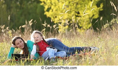 mother and daughter and tablet - Mom and daughter on nature...