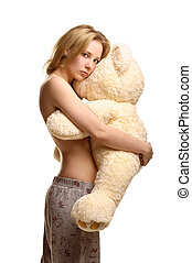 Girl in pijamas pants hugging giant plush bear - Concept:...