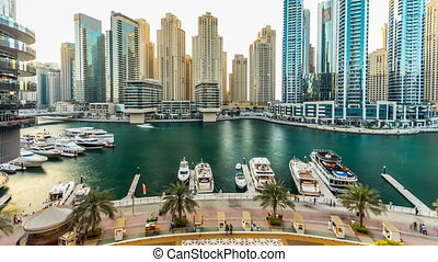 Dubai marina with modern buildings and traditional boat timelapse