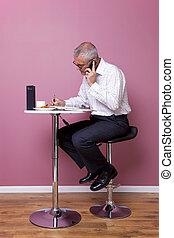 Businessman working lunch