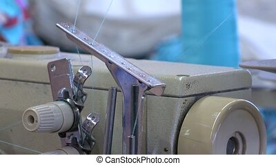 Factory seamstress at work and industrial sewing machine 4K video