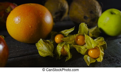 Cape Gooseberry on Wooden Table with Tropical Fruits
