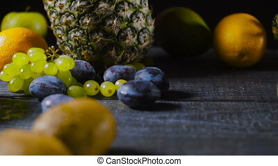 Grapes Falls and Splatters on Table with Fruits - Grapes...