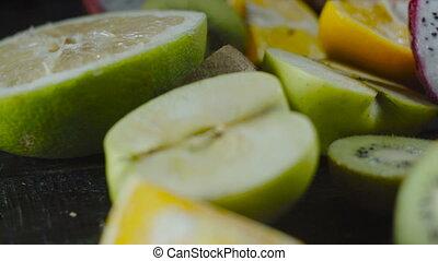 Slide on Exotic Tropical Fruits on Black Background - Slide...