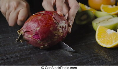 Chef Cuts Pitahaya On Dark Wooden Table - Chef Cuts Pitahaya...
