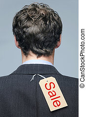 Sale label on the back of a mans jacket