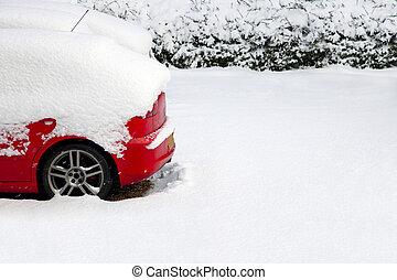Red car in the snow - Back of a red car covered after a...