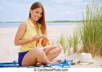 Woman with sun oil - Skin protection in summer Woman on...