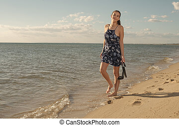 Woman walks with heels - Cheerful young dark brown hair...
