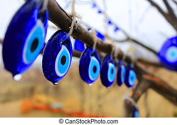 Nazars haning in Turkey - Glass blue Nazars, charms to ward...