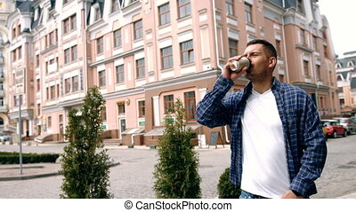 Young handsome man with coffee cup in London city