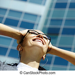 Happy businesswoman - outside photo with natural light on...