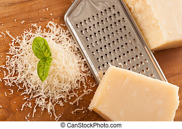 Parmesan cheese on wooden  plate isolated over white background