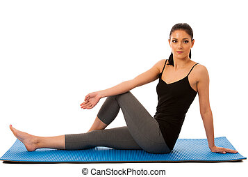 Beautiful fit hispanic woman doing stretching excercise...
