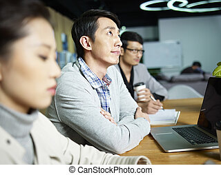 young asian businessman thinking during meeting - young...