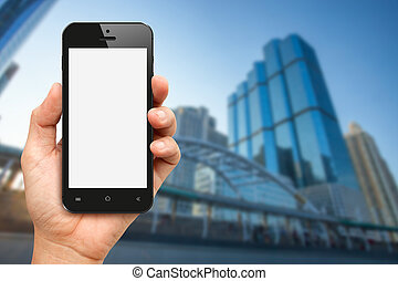 Hand holding blank screen smart phone with office buiding background