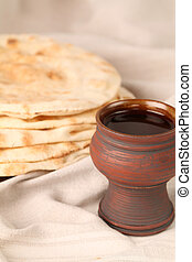 Wine and bread - Chalice with red wine and pita bread