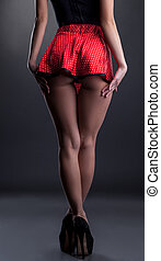 Back view of leggy girl in short red skirt