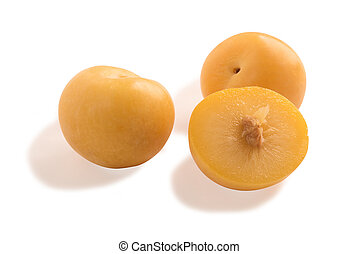 yellow plums and slice isolated in white background