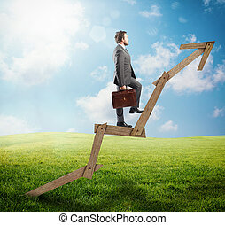 Success direction - Confident man climbing an arrow of wood