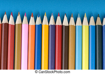 crayon on blue background