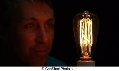 Man Antique Filament Bulb Amusement - Close up shot of a man...