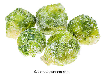 several frozen Brussels sprout cabbageheads isolated on...