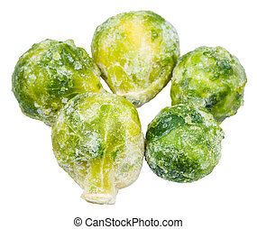 several frozen Brussels sprouts isolated on white background