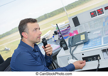 Man at work in control tower