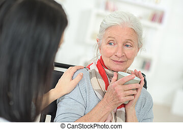 Senior woman being comforted by doctor