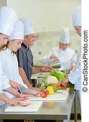 Chef talking to his students