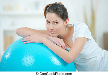 Lady with exercise ball