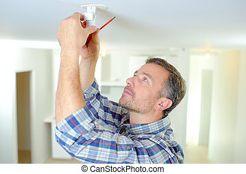 Fixing smoke alarm to the ceiling