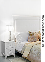 Nightstand - Detail of elegant cozy white bedroom nightstand...