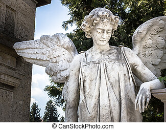 Weeping angel - Statue of an weeping angel leaning at a...