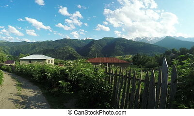 Fence in mountains - Wooden fence with barbed wire in a...