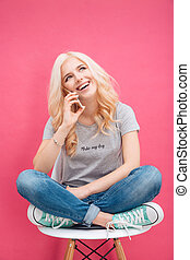 Smiling woman talking on the phone - Smiling blonde woman...