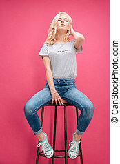 Attractive blonde woman posing on the chair