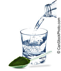 wheat grass and water in a glass isolated on a white...
