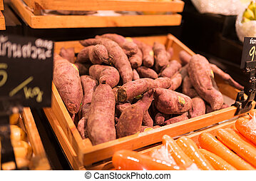 Sweet potato in market place - An Sweet potato in market...