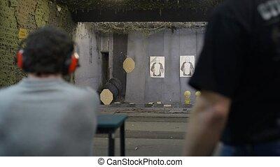 a man shooting at a shooting range