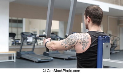 Man workout with power simulator in the gym
