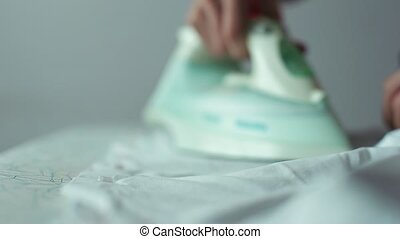 Man Ironing a White Shirt.